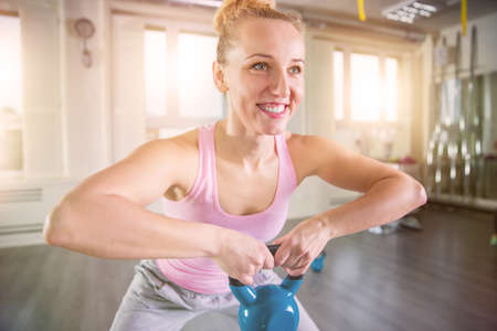 only women: Smiling woman working out on a gym