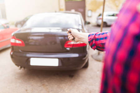 locking up: Close up of a man locking car with car key Stock Photo