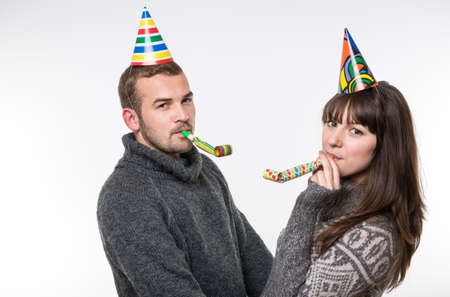 12 o'clock: Young happy couple wearing party caps Stock Photo