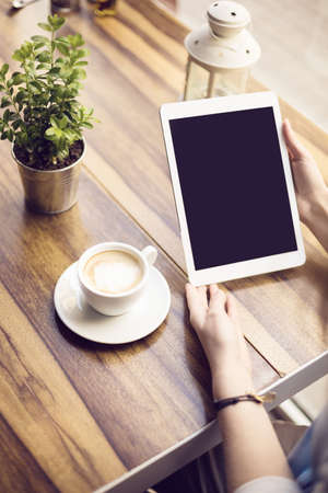 surfing the net: Surfing the net on digital tablet in cafe Stock Photo