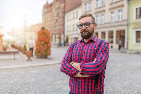 35 years old man: Man standing on the street in a small towns  market square
