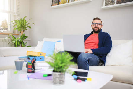 bespectacled man: Working at home is nice Stock Photo