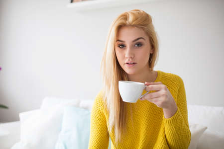 plainness: Sensual girl with cup of tea