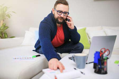 bespectacled man: Phone negotation