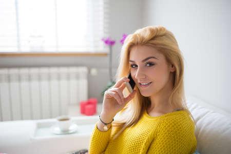 plainness: Pretty girl talking on the mobile Stock Photo