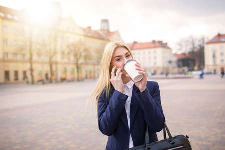 sip: Taking a sip of coffee Stock Photo
