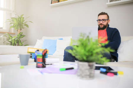 bespectacled man: Working overtime Stock Photo