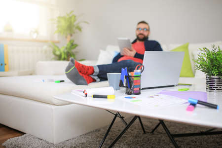 bespectacled man: Home workplace