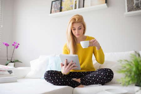 plainness: Girl in pajamas drinking tea