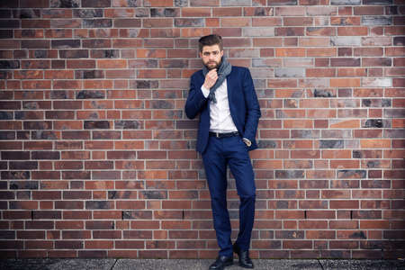 horizontal haircut: Businessman posing like a model Stock Photo