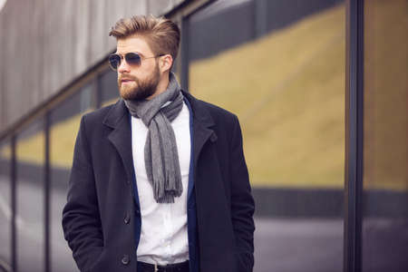 bespectacled man: Young businessman in sunglasses