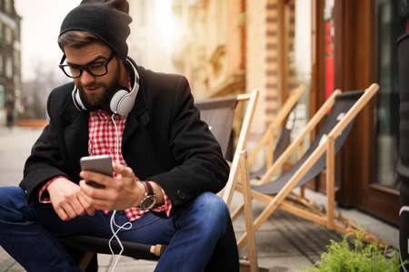 bespectacled man: Man reading interesting news online