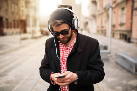 bespectacled man: I wonder if someone texted me? Stock Photo