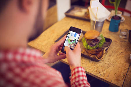 casual men: Taking a pic of food for social network site Stock Photo