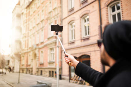 town square: Making selfie in the town square Stock Photo
