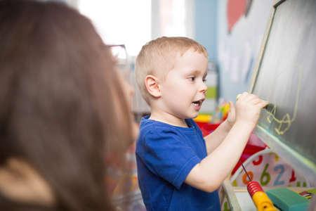 educator: Taking care of drawing boy