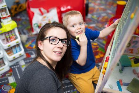educator: Taking care of kids is fun Stock Photo