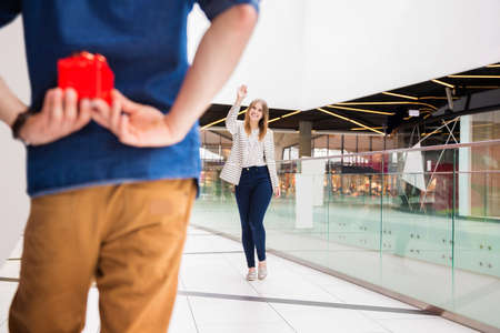 go inside: Girl greeting her boyfriend Stock Photo