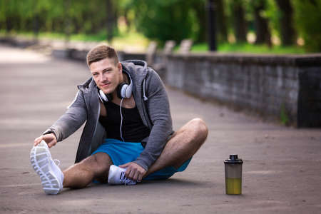 limber: Sporty man stretching out Stock Photo