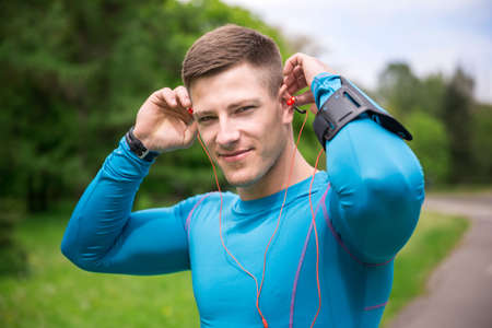 putting in: Putting the earphones in Stock Photo