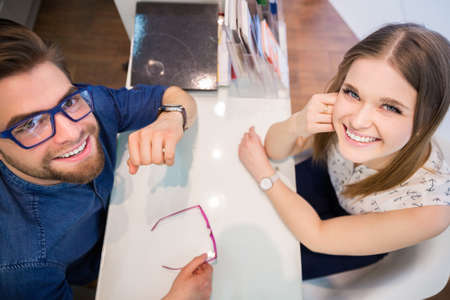 bespectacled man: Happy people at the counter
