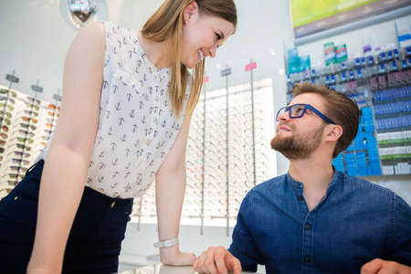 bespectacled man: Customer flirting with shop assistant