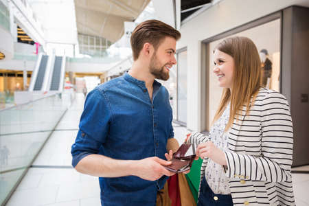 spending: Young couple spending time shopping