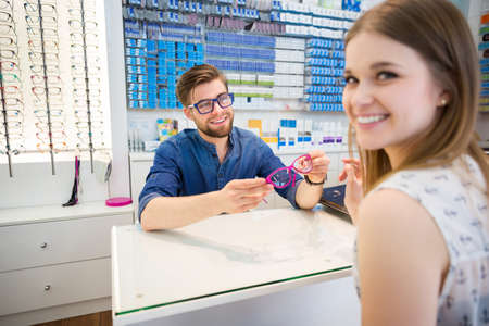 bespectacled man: Man flirting with his customer