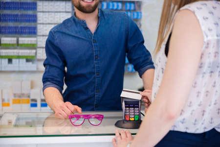 buying: Woman buying glasses