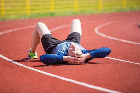 tired: Tired sportsman Stock Photo