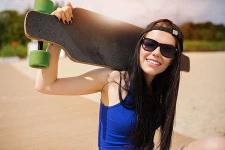Longboarder in the sunshine Stock Photo