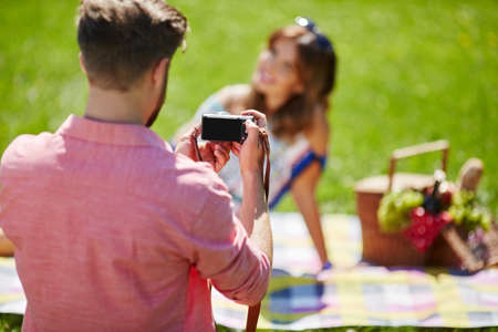 love pic: Man taking a photo of a beautiful girl