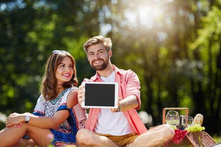 presenting: Man presenting best tablet Stock Photo