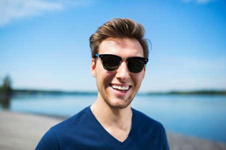 Happy man at the lake