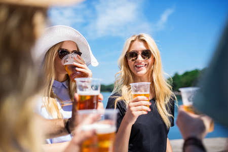 bespectacled man: Happy girl with friends Stock Photo