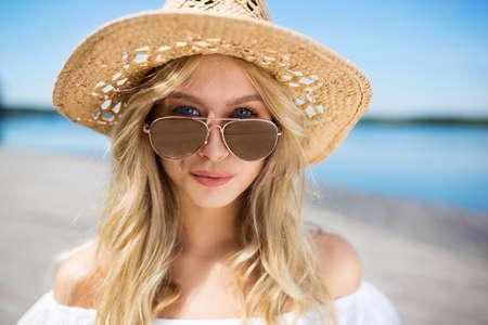 ladylike: Girl in panama hat Stock Photo