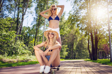 Two girls and the skateboard