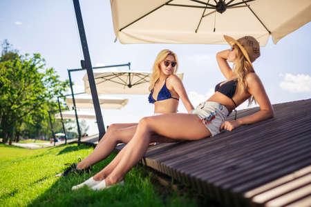 sunshade: Conversation under the sunshade Stock Photo