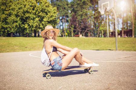 Sitting on the skateboard