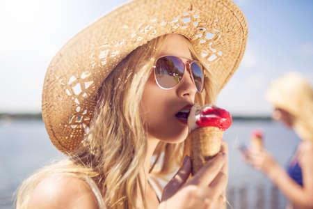 comiendo helado: Sensual girl eating ice cream Foto de archivo