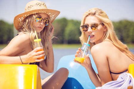 Beautiful women drinking juice