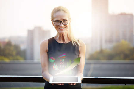 Professional businesswoman holding tablet Stock Photo