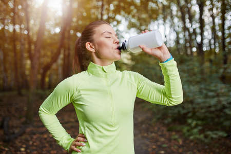 isotonic: Sportswoman drinking isotonic drink