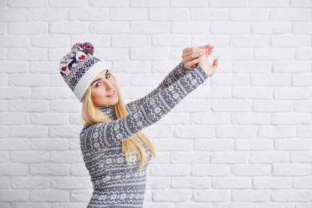 strecthing: Woman in winter cap strecthing out Stock Photo