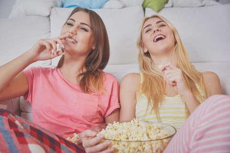 hilarious: Watching hilarious movie Stock Photo