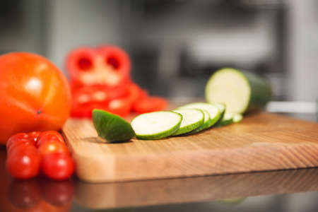 Sliced vegetables on cutting board Stock Photo