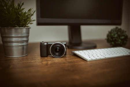 plainness: Digital camera on the desk Stock Photo