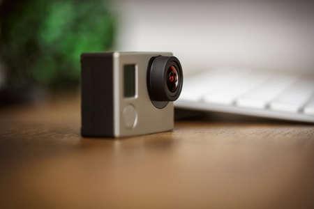 filmmaker: action camera standing on the desk
