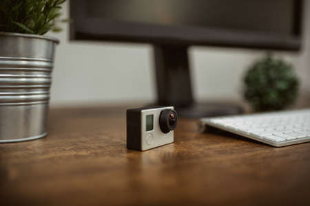 plainness: action camera standing on desk