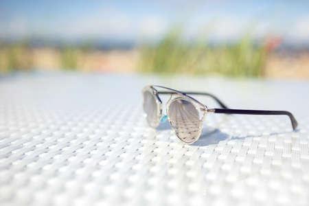 plainness: Glasses lying on table outside